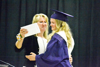 Dana Rosener hugs Allie after handing her diploma