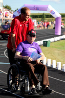 Tate Cunningham pushing his grandfather Gerry Cunningham
